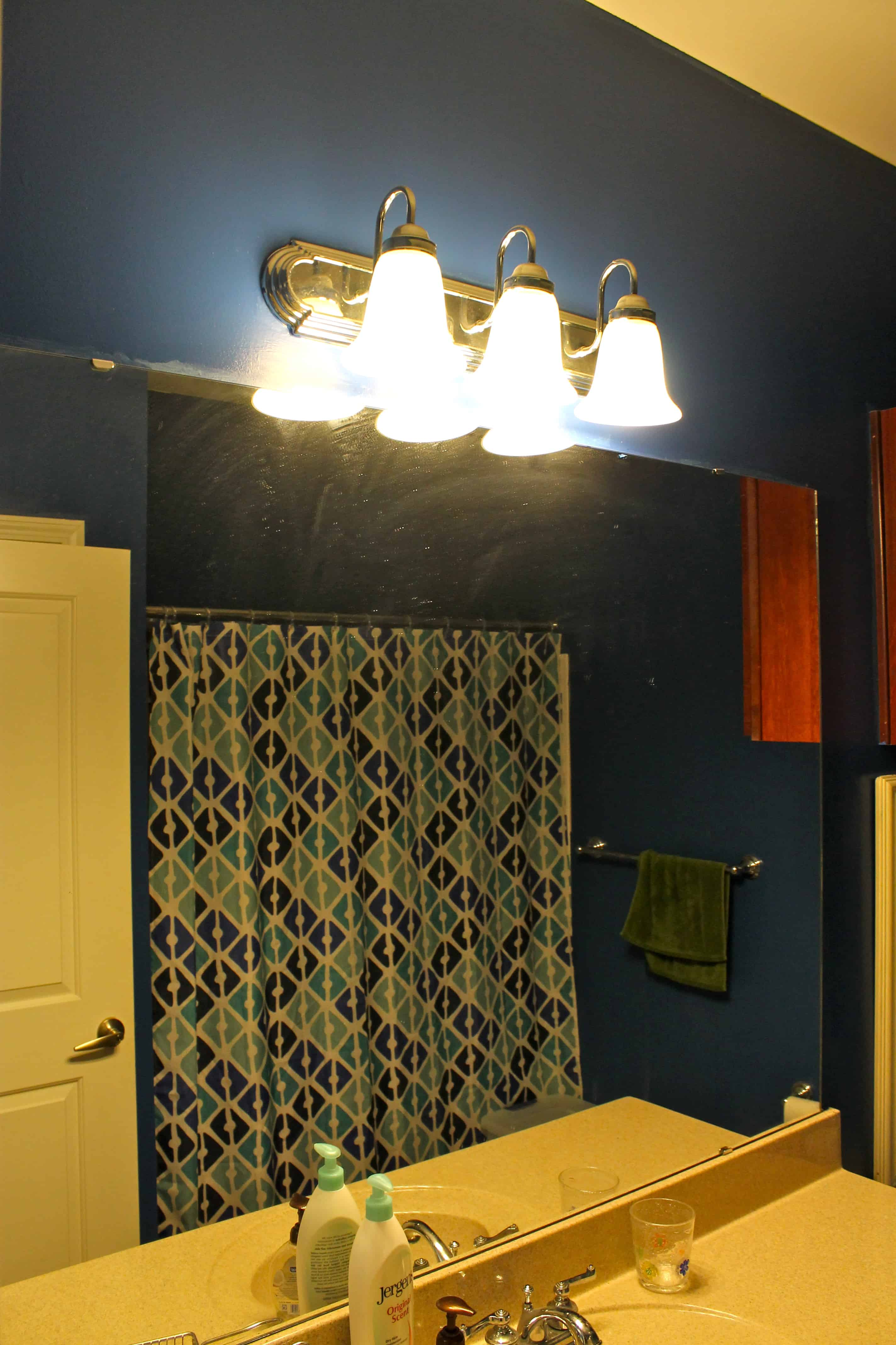 Upgrading A Standard Bathroom Light Fixture With A Dip Of