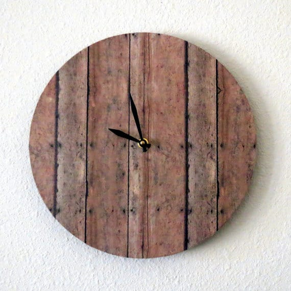 Update Your Clock for daylight savings time - a wooden wall clock