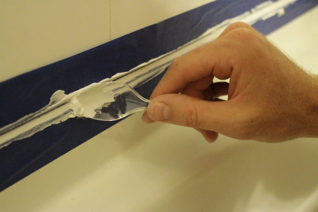 Refresh your Tub by Replacing the Caulk - Charleston Crafted