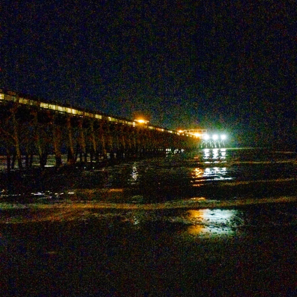 Folly beach pier at night - charleston crafted