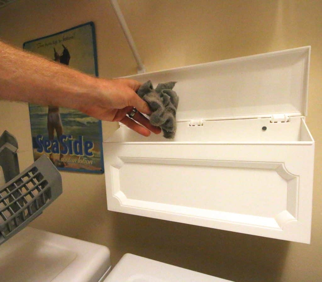 DIY Wall Mounted Laundry Room Trash Can Hack - Charleston Crafted