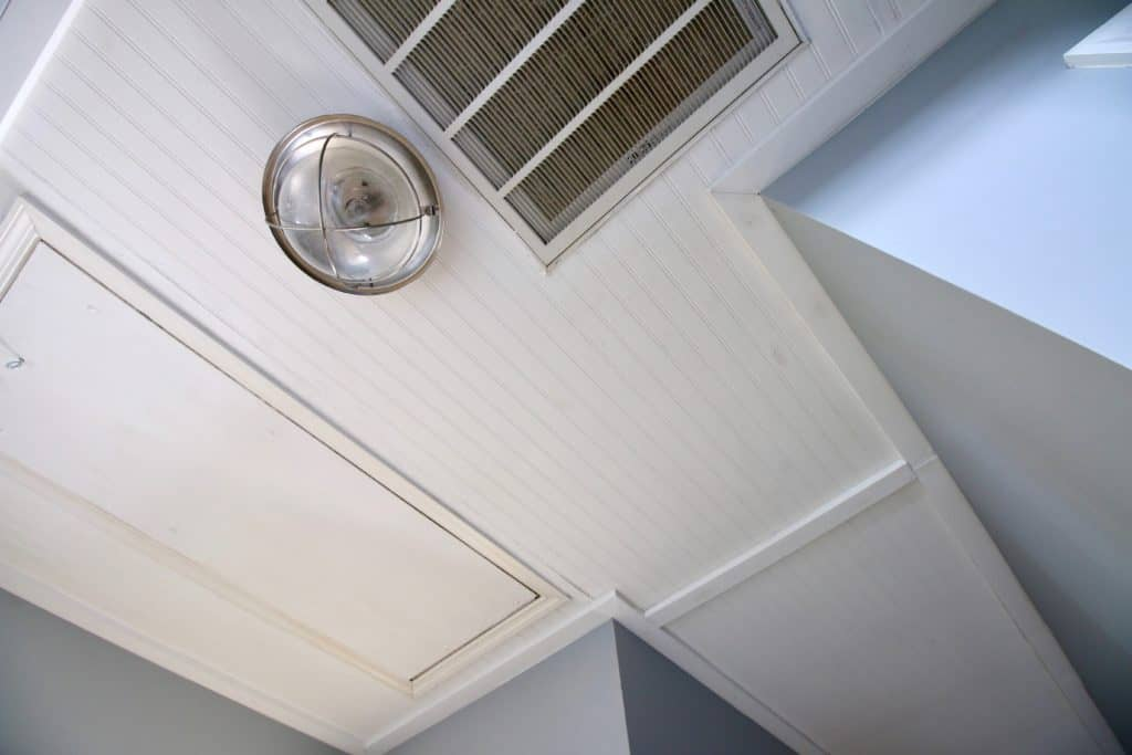 How to Cover Popcorn Ceilings with Beadboard ceiling- Charleston Crafted