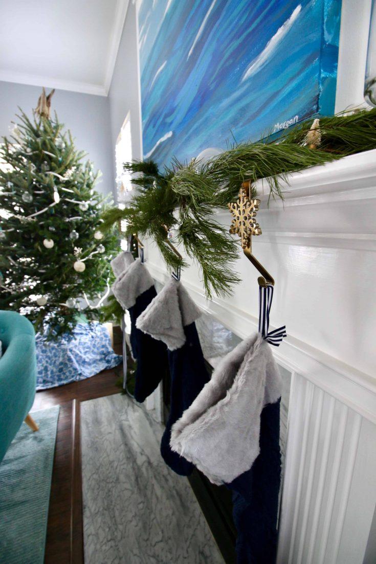 A CoastDIY Sweater & Faux Fur Stockings via Charleston Craftedal Christmas Mantel via Charleston Crafted