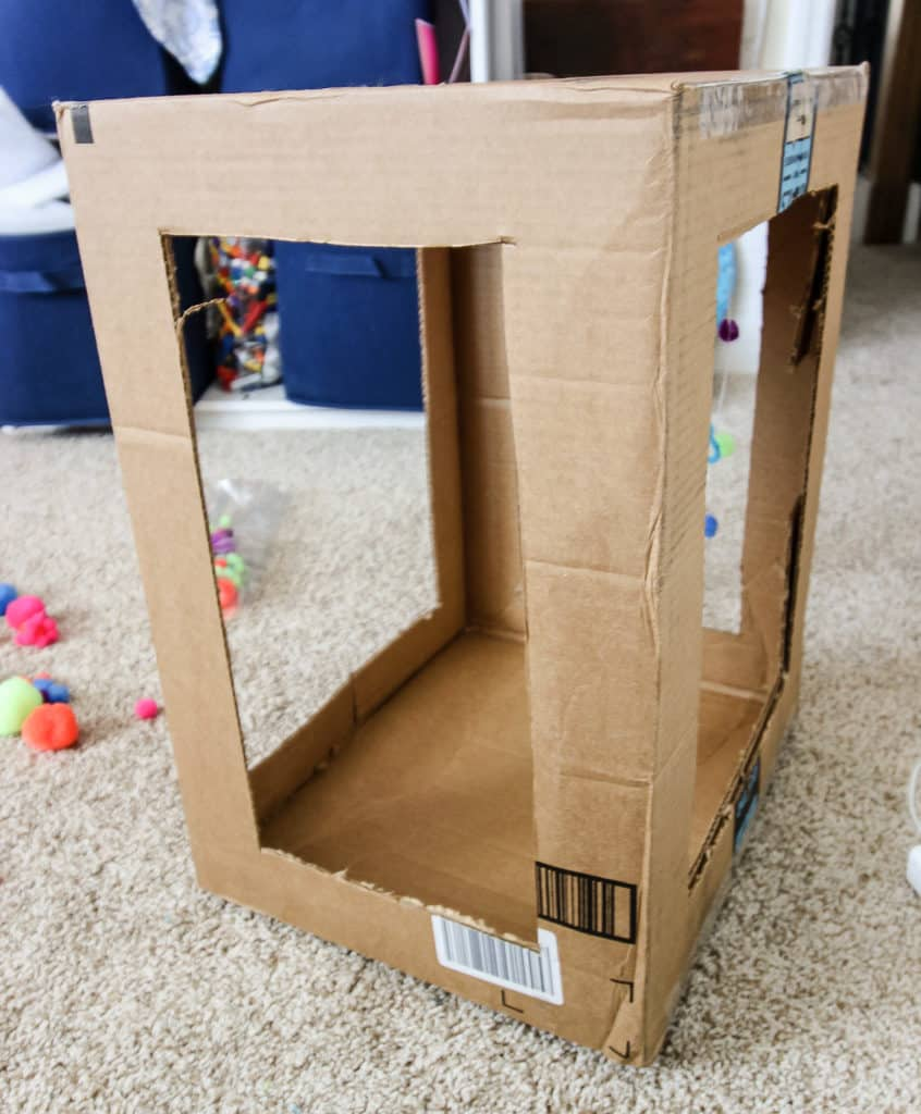 DIY Cardboard Cat Play Box via Charleston Crafted