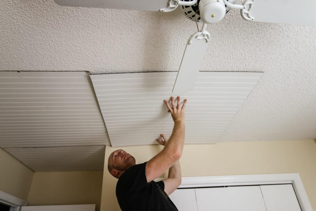 Placing bead board on ceiling