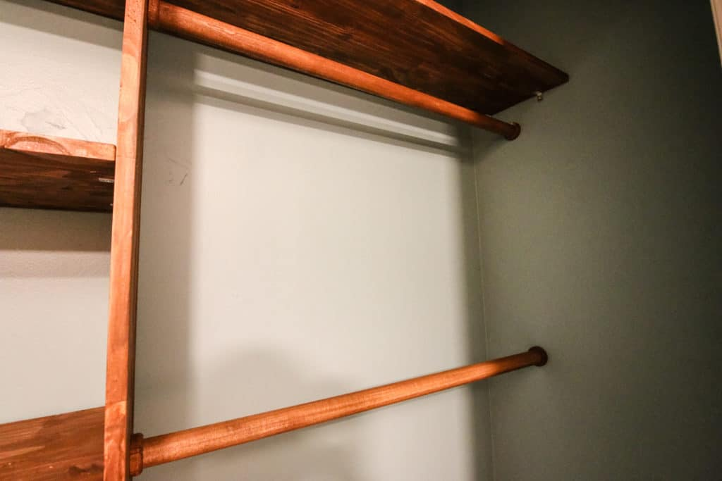 Nursery closet system with poles