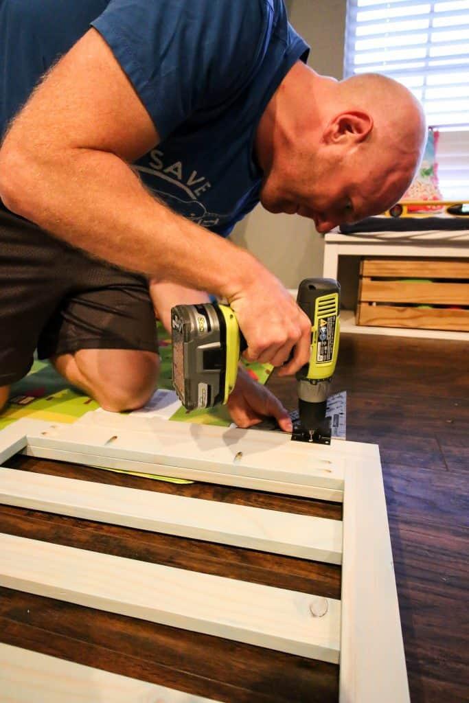 installing a wooden playpen