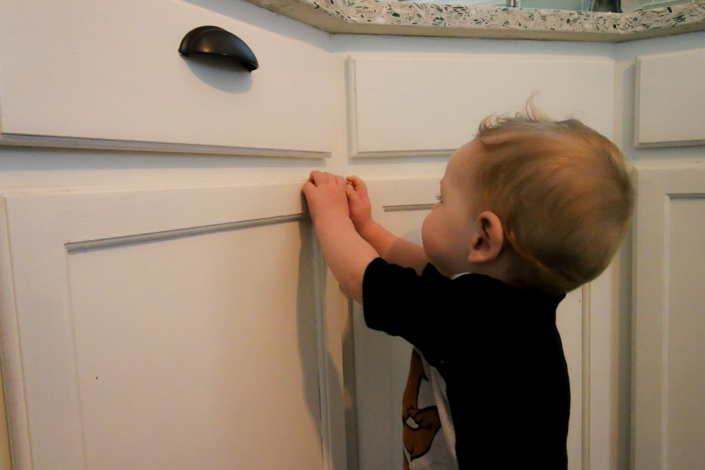 Kid can't open cabinet with Eco Baby Magnetic Safety Locks