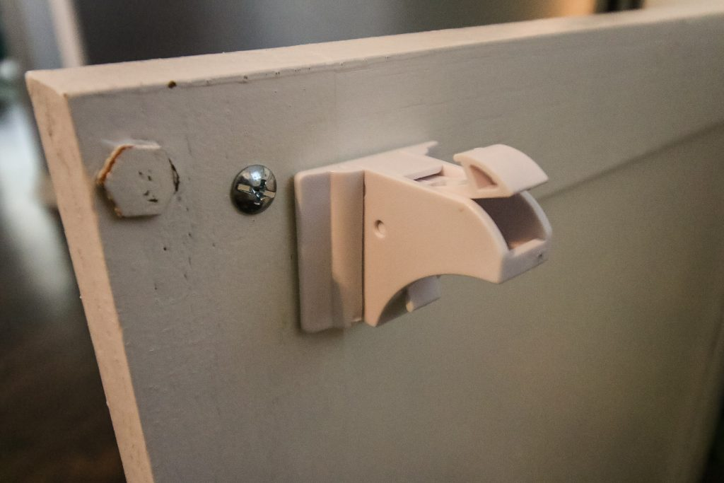 Latch installed to cabinet door