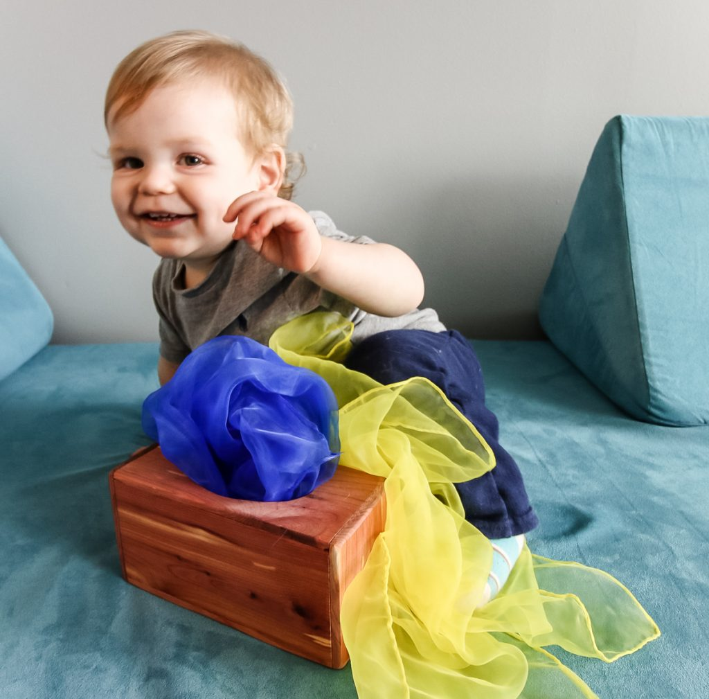 Pulling scarves from DIY magic tissue box