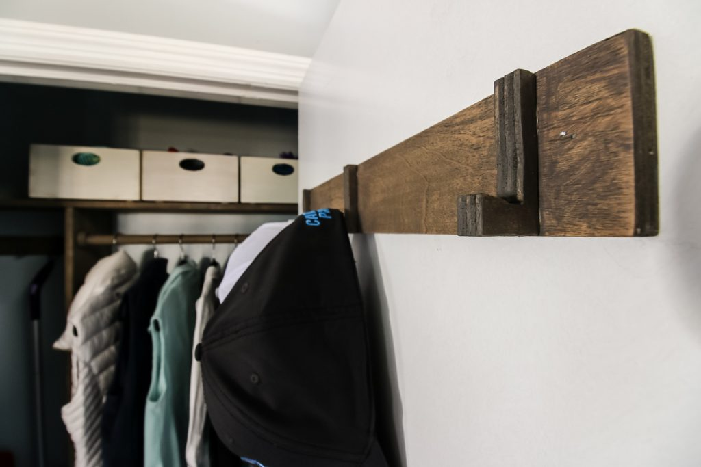 DIY wooden hooks for hats in an entrycloset