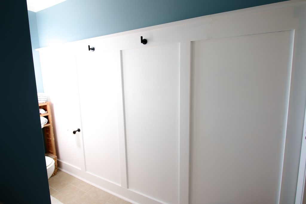Wide view of bathroom accent wall