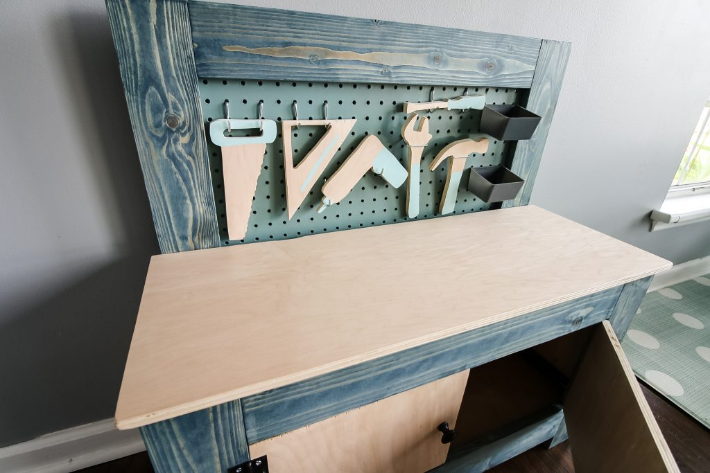 Wooden tool set on toddler workbench