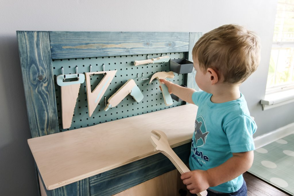 Playing with wooden tool set