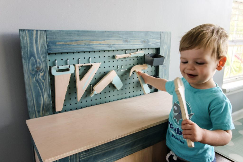 Playing with toddler workbench