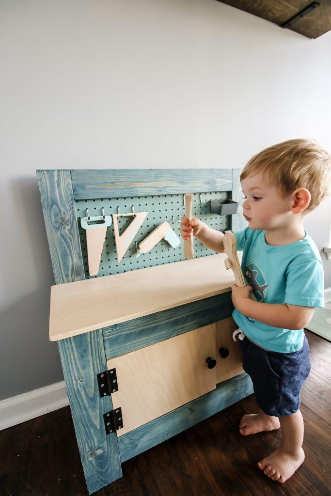 Toddler using toddler workbench