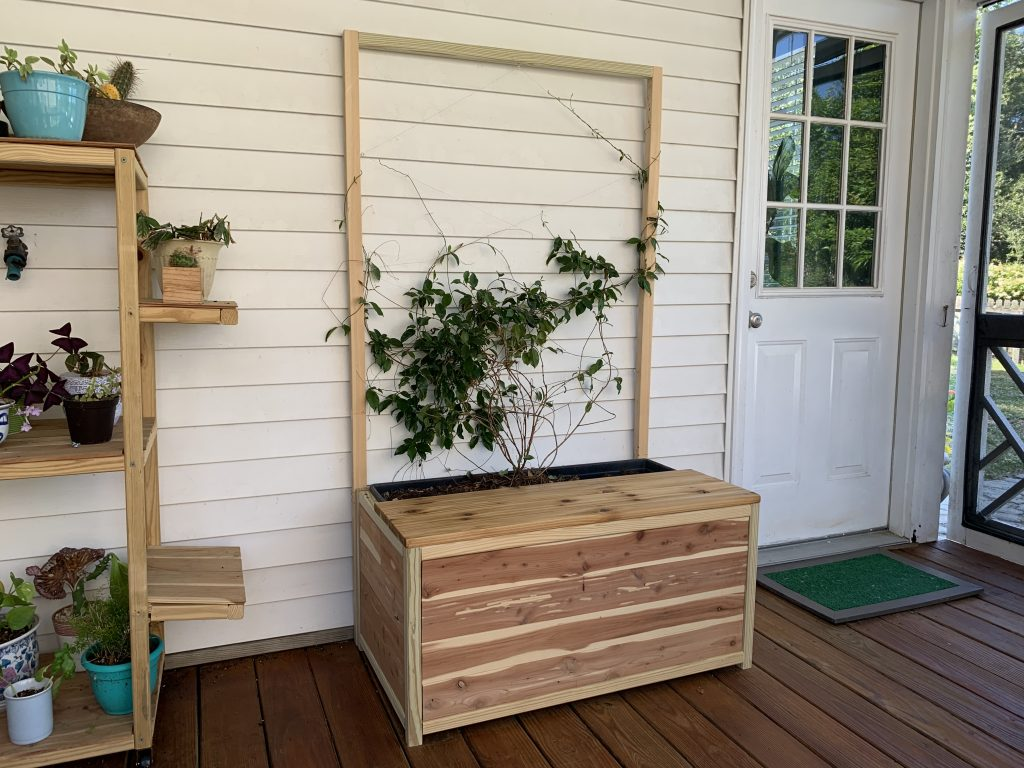 DIY planter bench with trellis and storage
