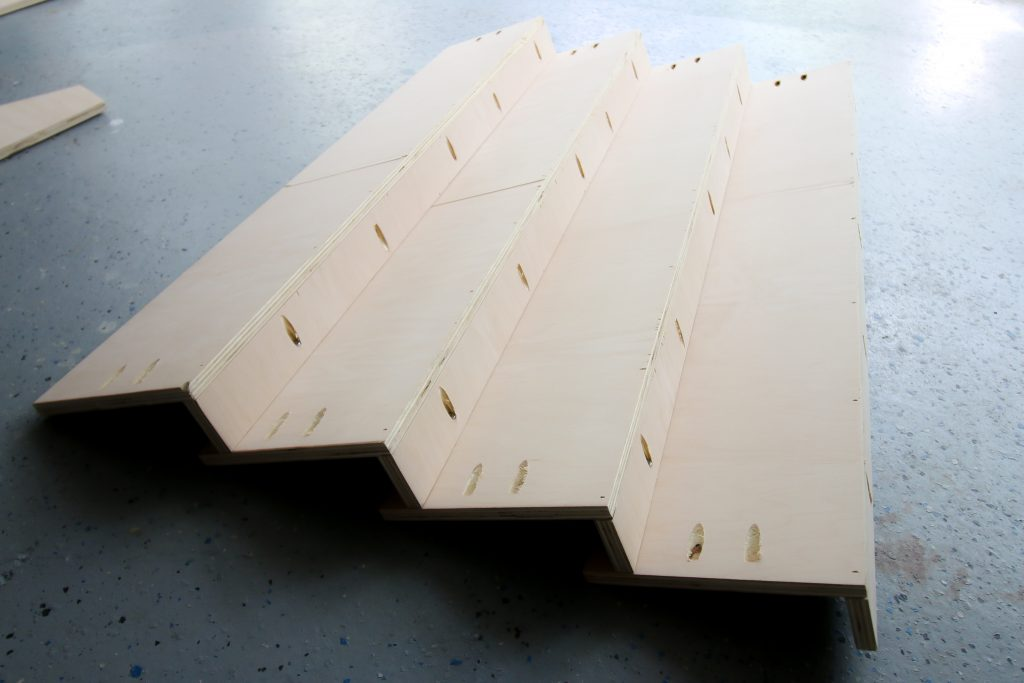 Building shelves for front facing bookshelf