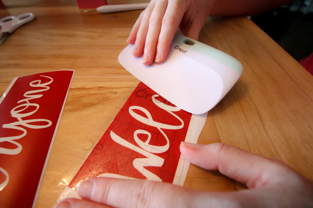 applying transfer tape to a cricut vinyl stencil