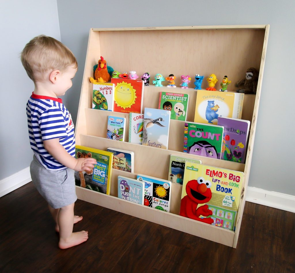 Toddler with front facing bookshelf