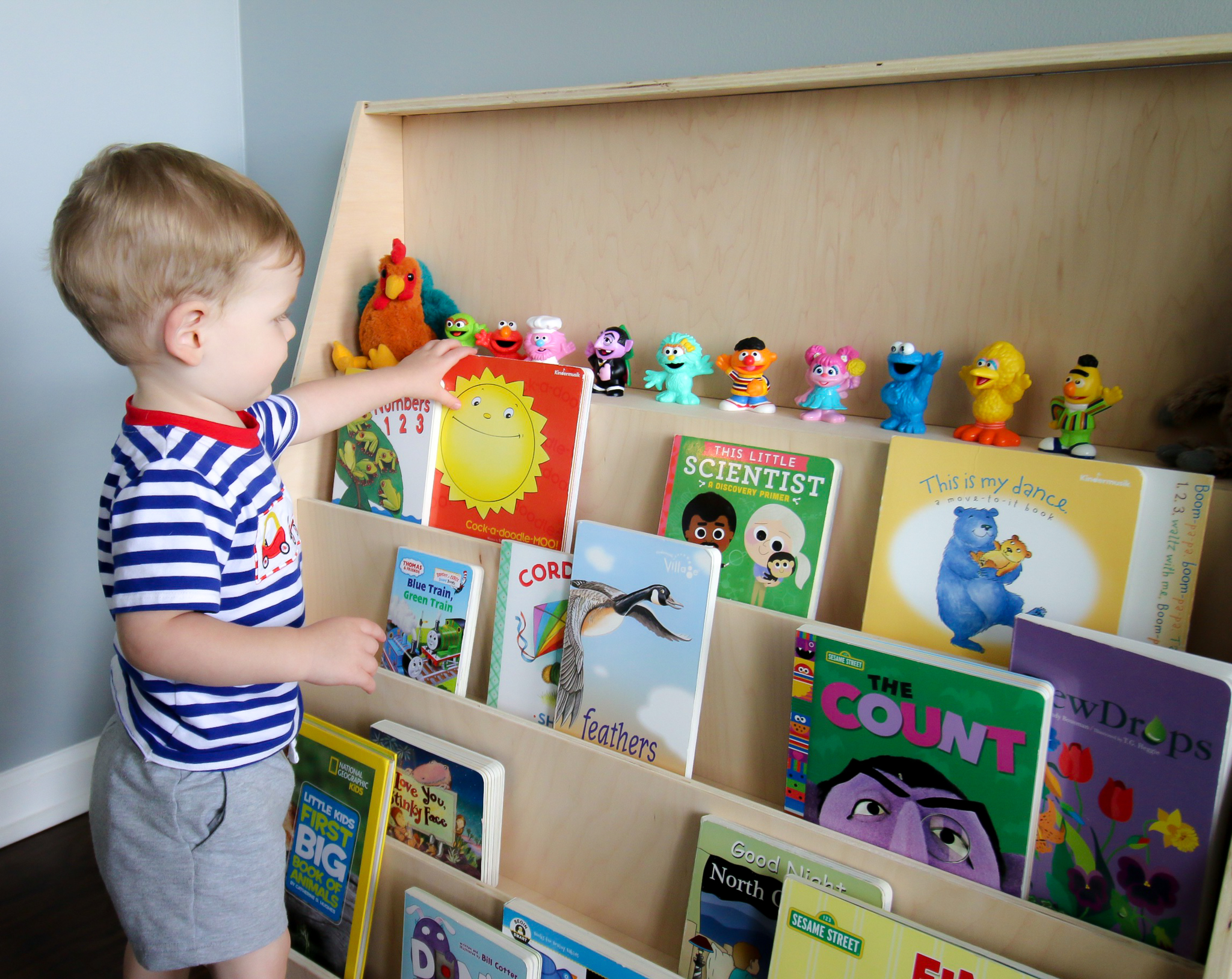 Toddler reaching for book