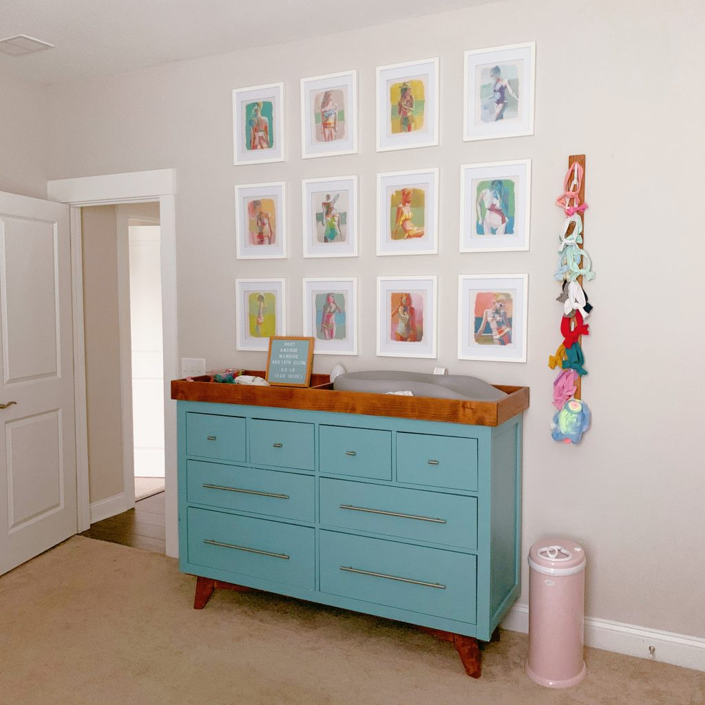 Sherwin Williams Agreeable Gray in a Bedroom with blue dresser