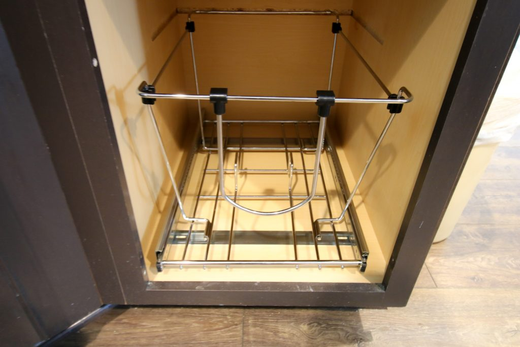 Attaching pull out trash can system to cabinet
