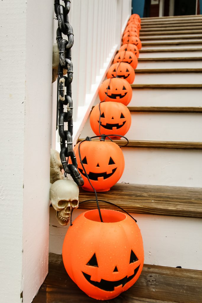 pumpkins up the stairs Our DIY Halloween Porch Decor