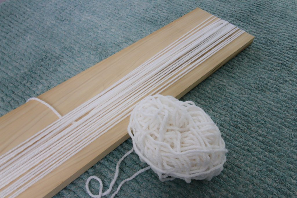wrapping yarn for a wall hanging
