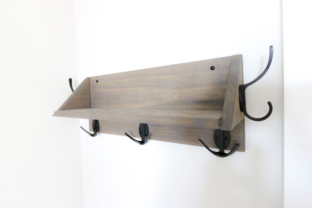 Wooden wall mounted entry shelf with hooks