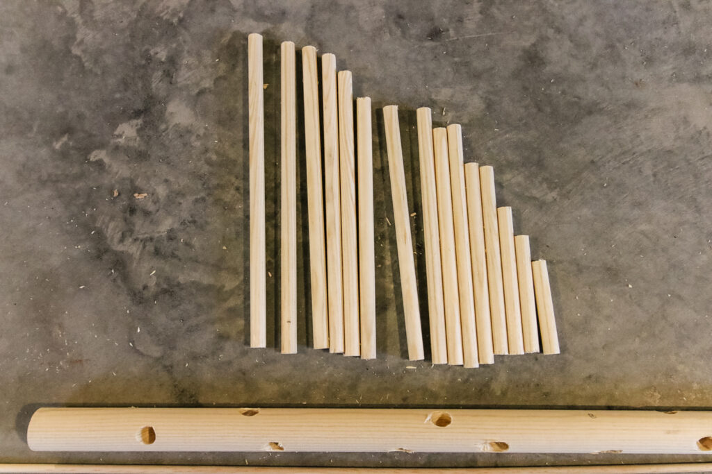 dowels cut and ready to make a dowel christmas tree