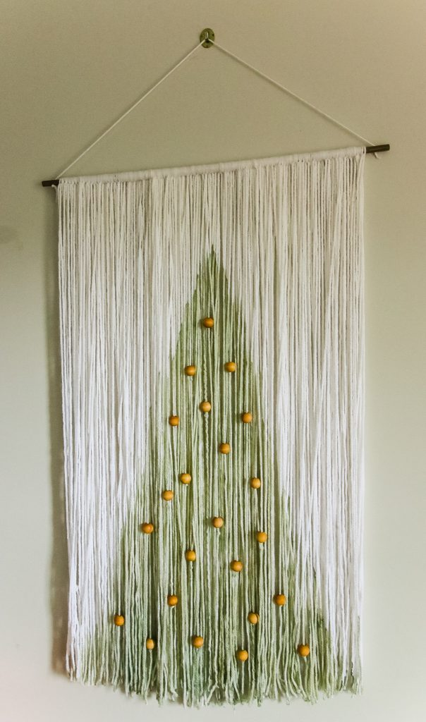 Christmas yarn and wood wall hanging