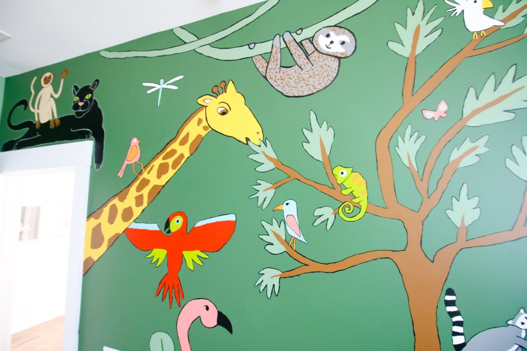 Outlined paintings in a mural on a bedroom wall