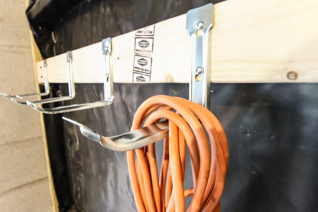 close up of extension cord storage hooks