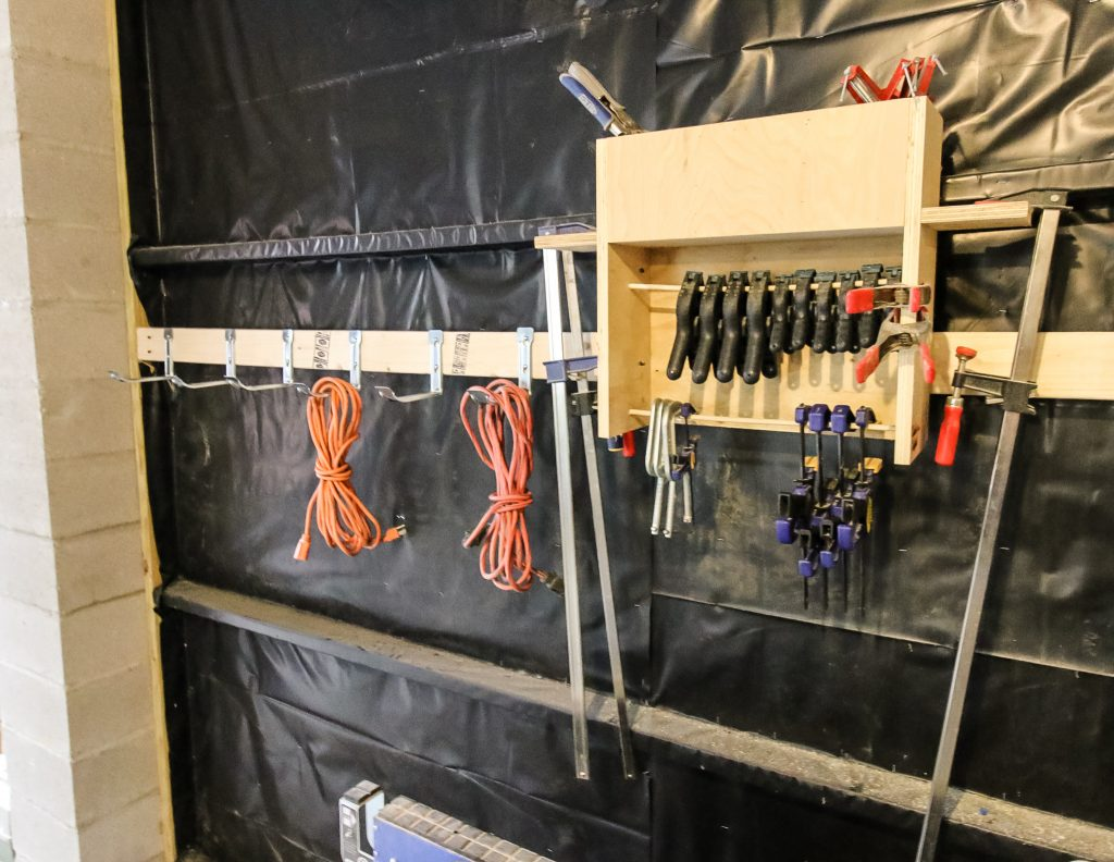 hang extension cords on the wall using these hooks