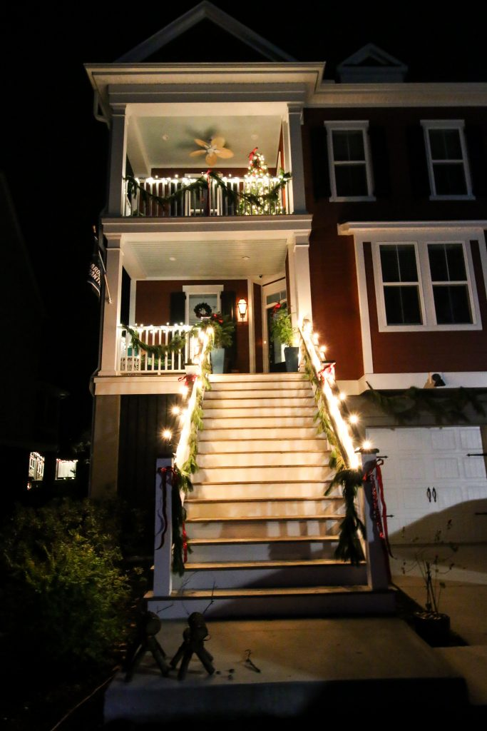 Christmas double porches with garland and red bows