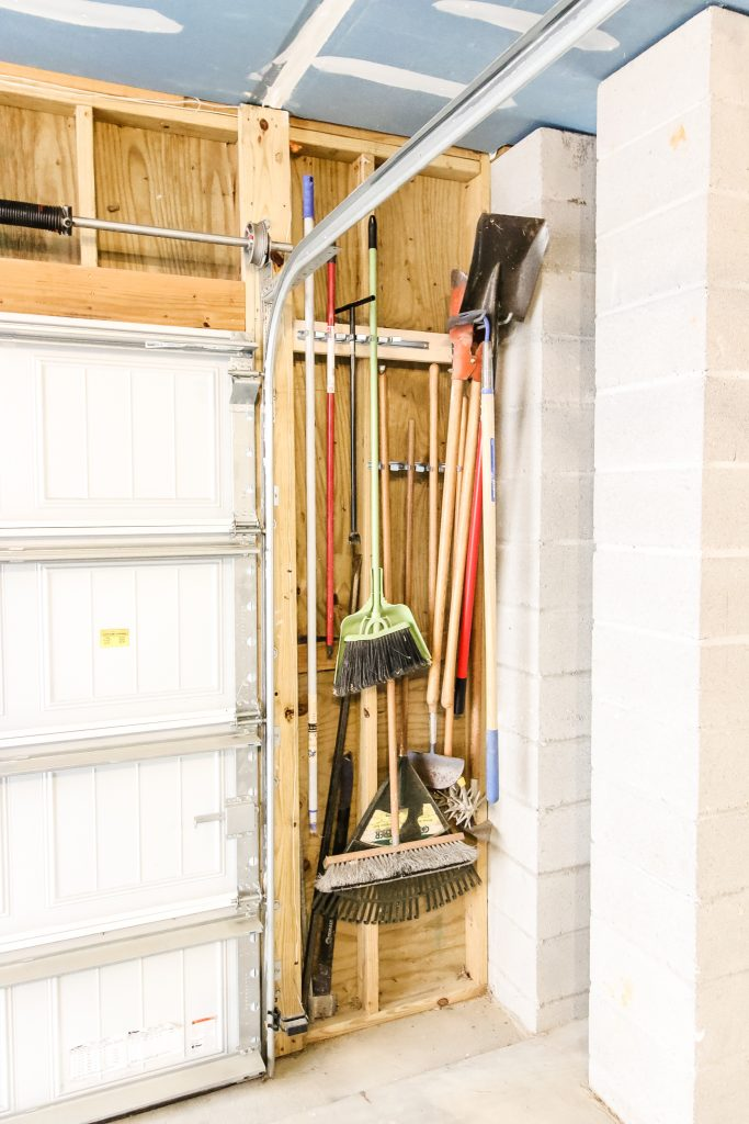 Outdoor tools in wall clips in garage
