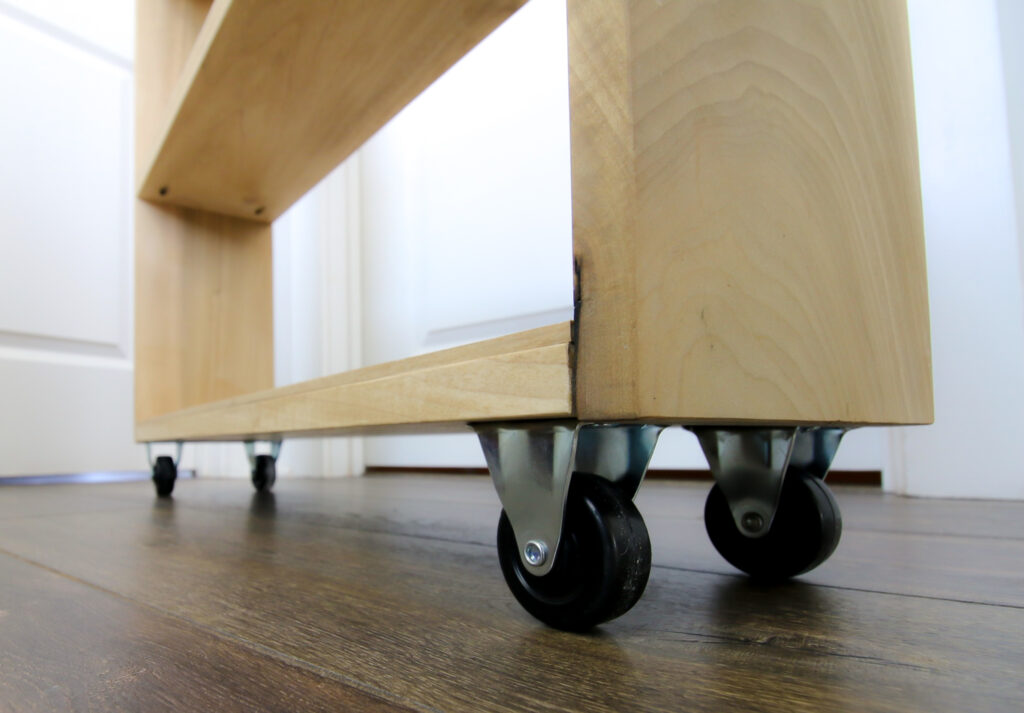 Casters on rolling laundry cart
