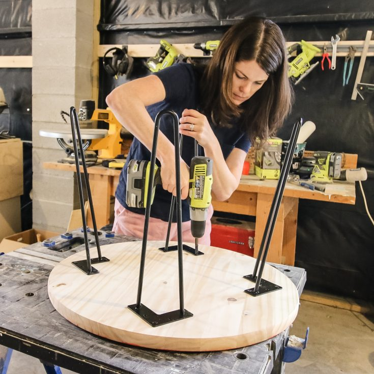 screwing hairpin legs into a round wooden tabletop