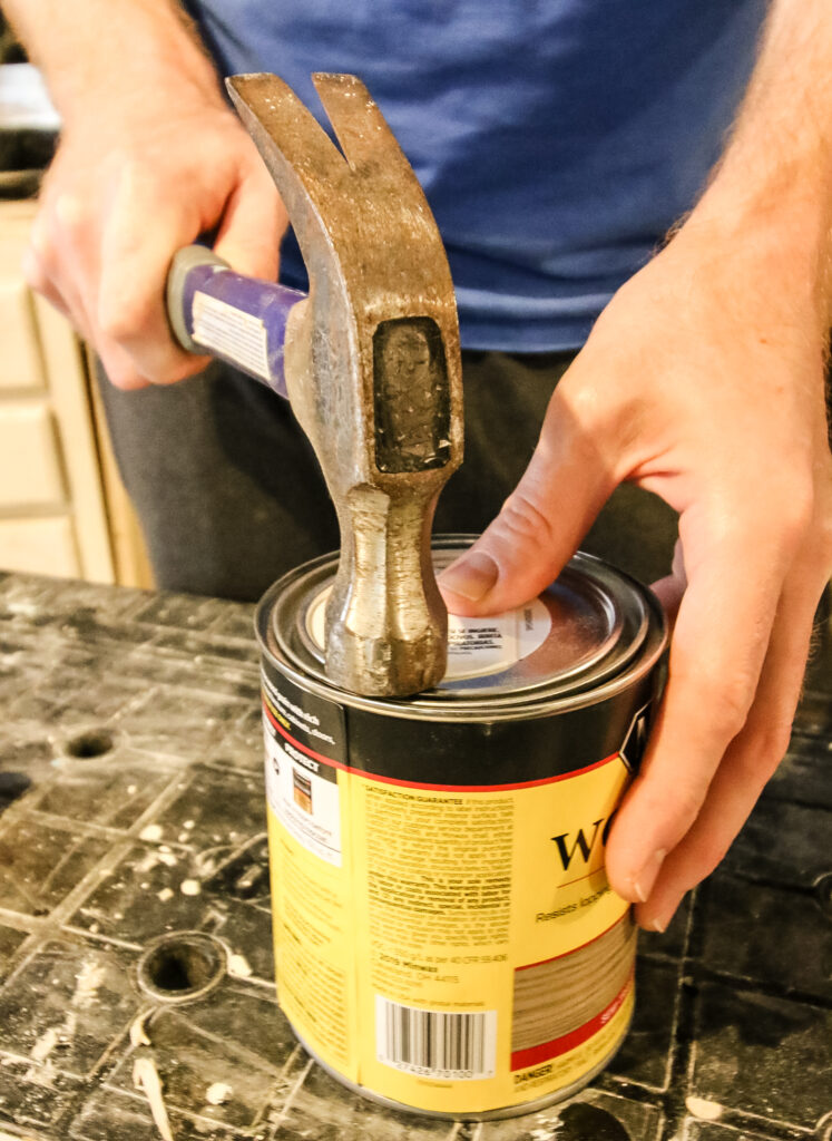 how to close a can of woodstain with a hammer