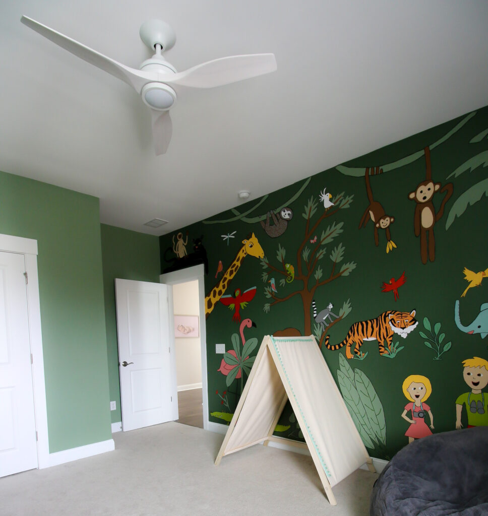 jungle themed nursery with spitfire fan by fanimation in white
