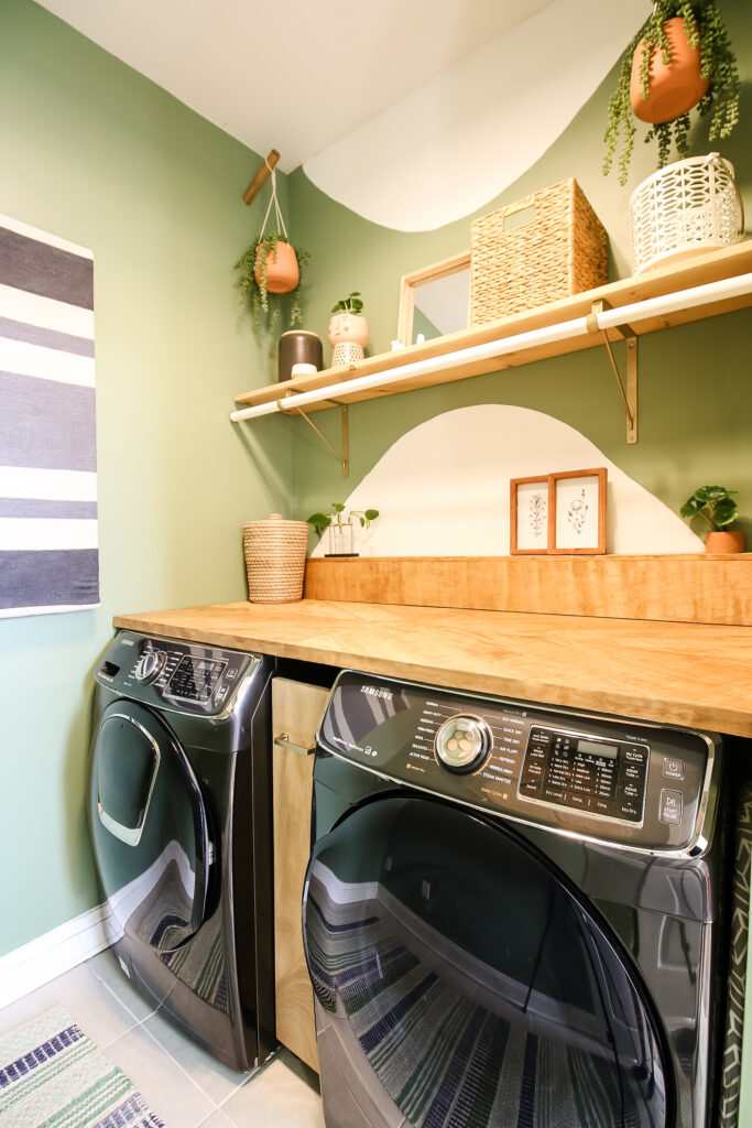 Rug hanging in boho laundry room