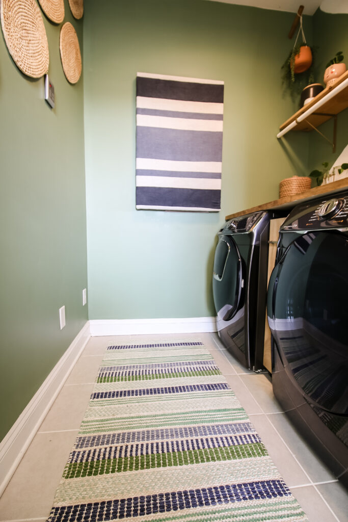 Rug hanging on wall in laundry room