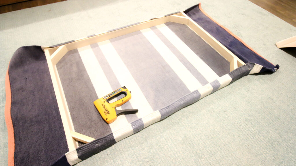 Stapling rug to wood frame