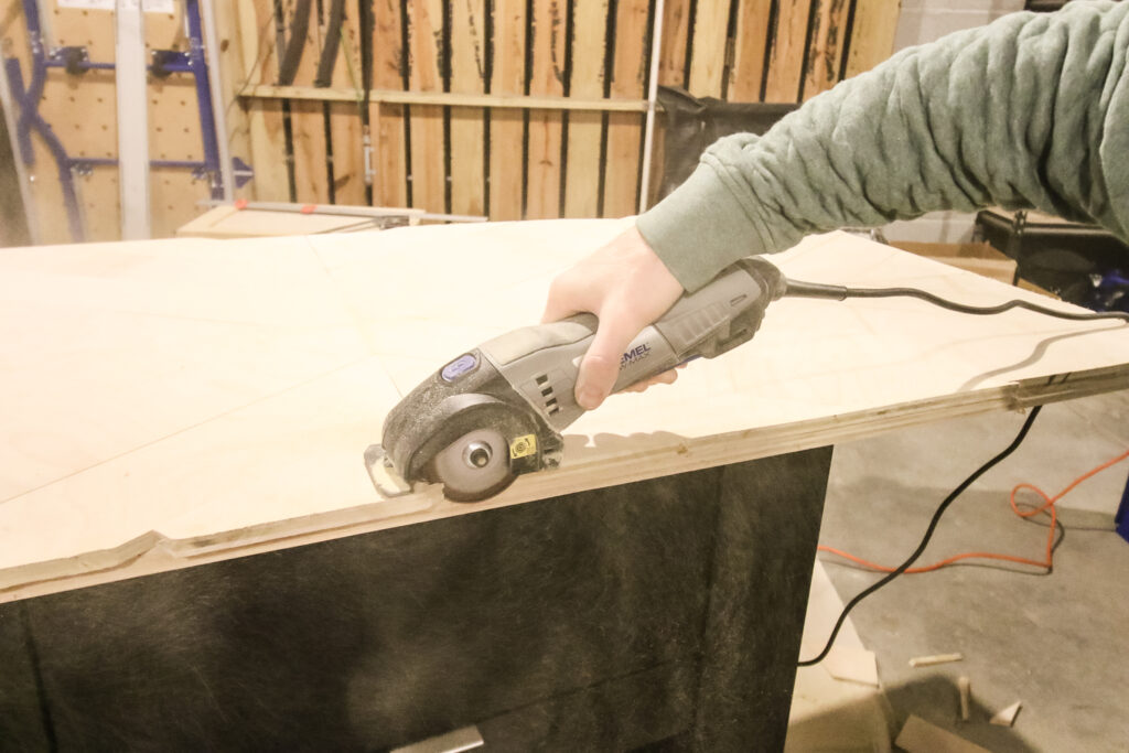 Cutting off excess of geometric plywood counter top