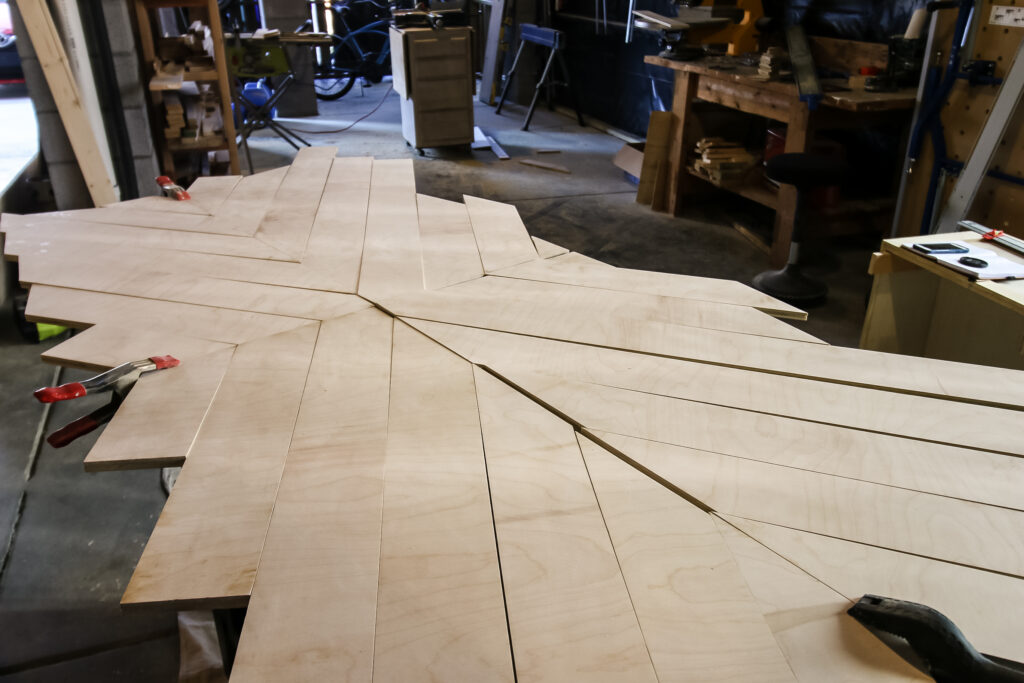 Angled pieces for geometric wood table top