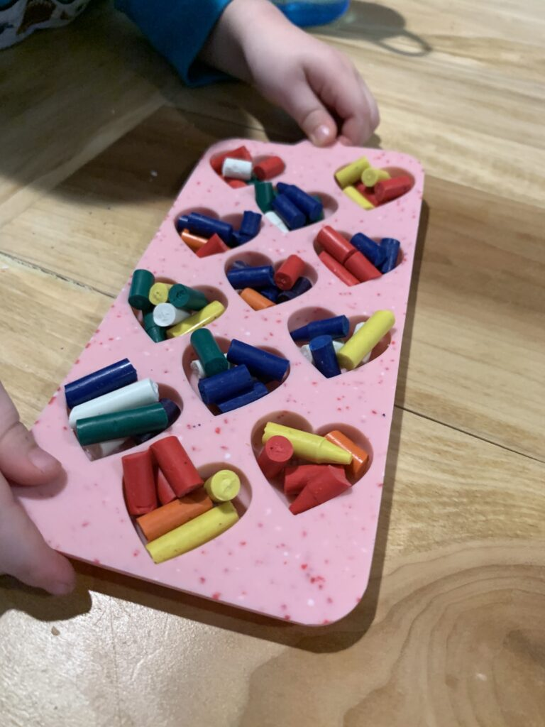 heart shaped silicone mold filled ready to melt crayons