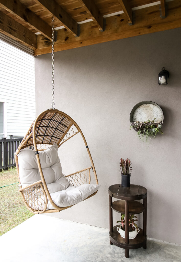 wooden side table on a covered patio