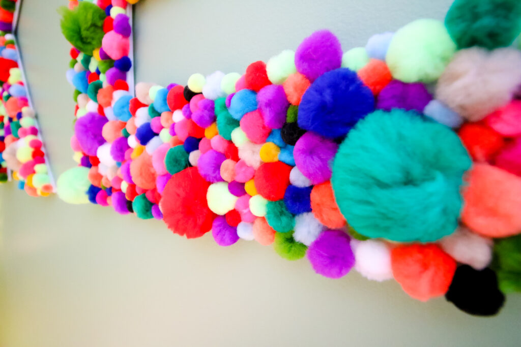 Close up of pom pom letters