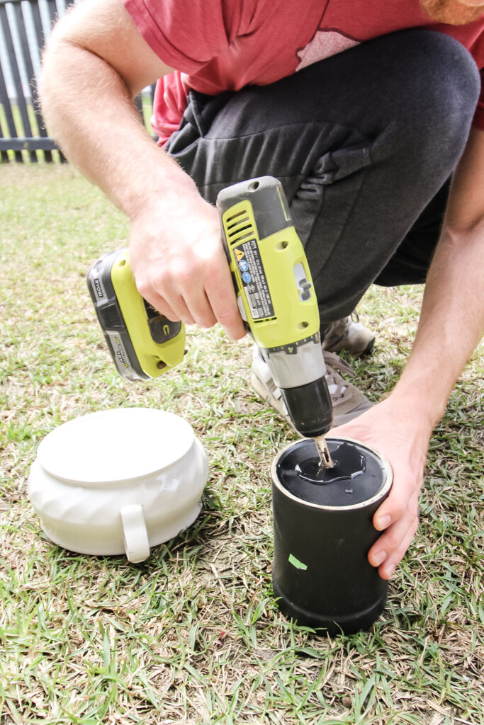 Drilling a hole for drainage in the bottom of a ceramic container to use as a pot